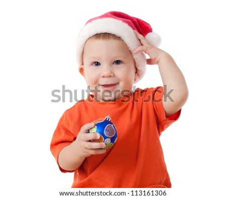 Smiling baby with Christmas decoration and Santa's hat, isolated on white - stock photo