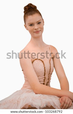 Smiling ballerina against a white background