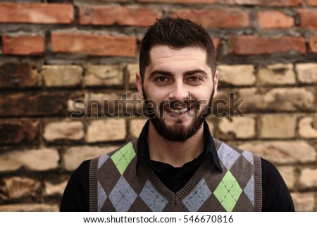 smiling bearded young man