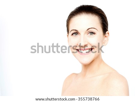 Smiling beautiful blonde woman with bare shoulders