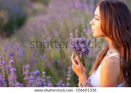 smiling beautiful brunette in the lavender field - stock photo