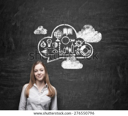 Smiling beautiful business lady is thinking about business development. Drawn cloud on the wall with business icons - stock photo