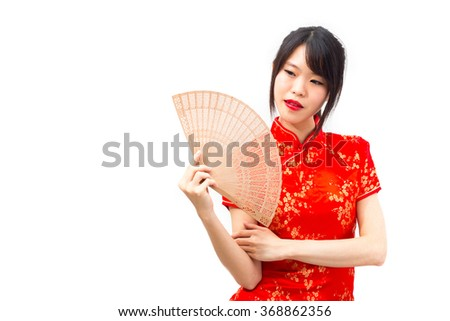 Smiling beautiful Chinese woman dressed traditional cheongsam and introduce on white background, Chinese new year concept