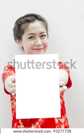 smiling beautiful chinese woman with tradition clothing with copy space