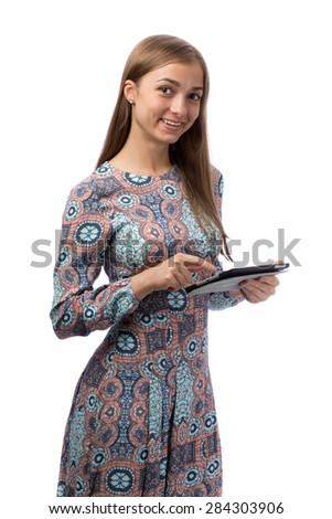 Smiling beautiful girl in the Tablet PC in the studio, isolate on white background. - stock photo