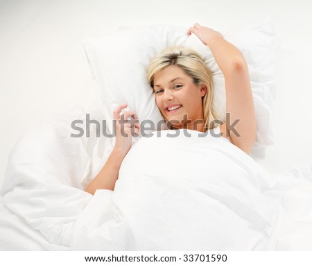 Smiling beautiful girl resting in bed