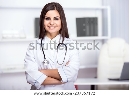 Smiling, beautiful medical doctor woman in medical room. - stock photo