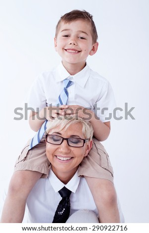 Smiling beautiful mother playing with her little son, having fun. - stock photo