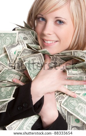 Smiling beautiful woman holding money - stock photo