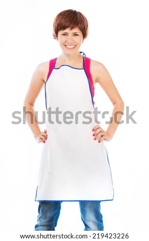 Smiling beautiful woman in apron isolated on white - stock photo