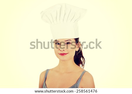 Smiling beautiful woman in chef hat. - stock photo