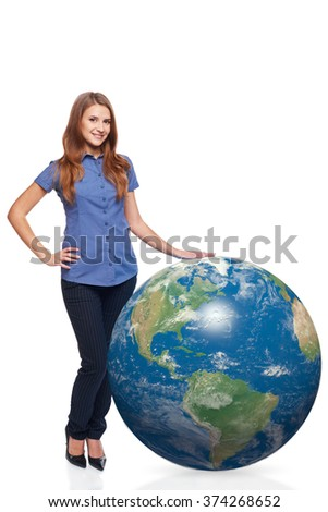 Smiling beautiful woman in full length standing with earth globe, American continent in front, over white background