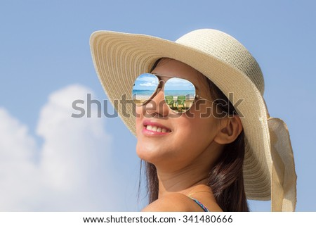 Smiling beautiful woman  on a beach with hat beach recreation concept  - stock photo