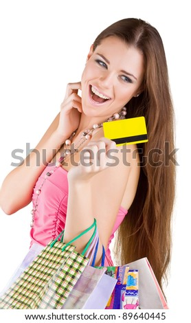 Smiling beautiful woman pulled from the purse Credit card, isolated on white background