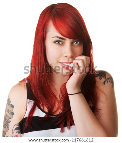 Smiling beautiful woman with red hair biting her nails - stock photo