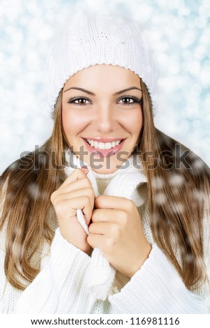 Smiling beautiful woman with white hat and scarf - stock photo