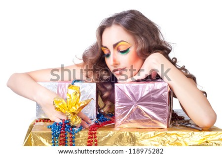 smiling beautiful womanl with bright make-up and gift boxes - stock photo