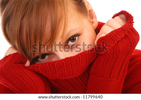 Smiling beautiful young woman  in red sweater on white background - stock photo