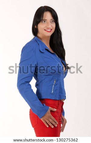 smiling black-haired woman with blue jacket and red pants / Some like it in color - stock photo