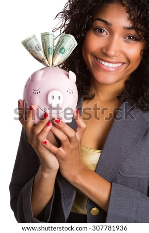 Smiling black woman holding pink piggy bank - stock photo