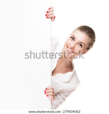 Smiling blond woman holding signboard isolated over white background - stock photo