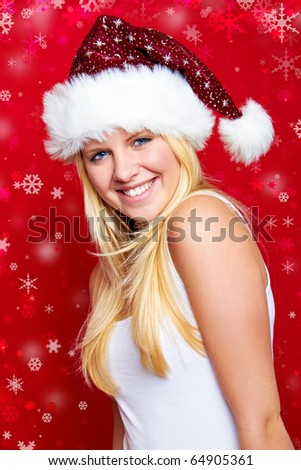 smiling blond woman on christmas on red background with snowflakes - stock photo