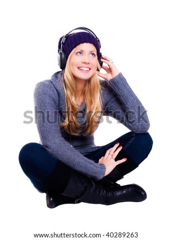 smiling blond woman with headphones listening music over white - stock photo