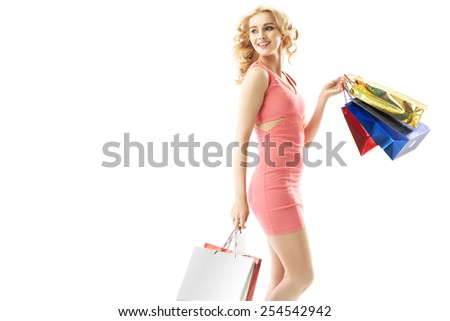 Smiling blonde beauty on shopping trip - stock photo
