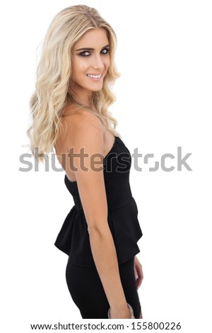 Smiling blonde model in black dress posing looking at camera on white background