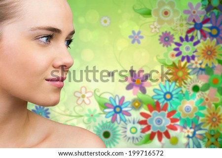 Smiling blonde natural beauty against digitally generated girly floral design - stock photo
