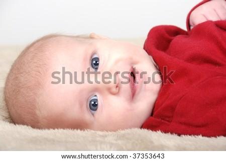 Smiling blue eyed baby - stock photo