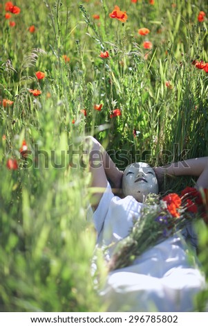 Smiling blue-eyed woman  portrait in summer field - stock photo