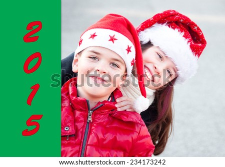 Smiling boy and girl wearing Santa Claus hat - stock photo