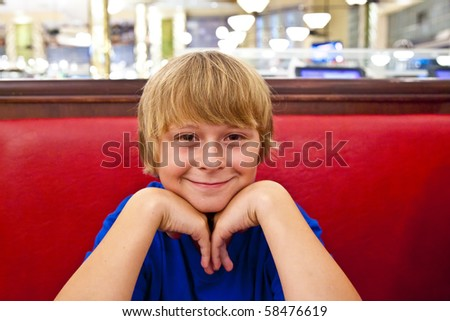 smiling boy at a diners at night