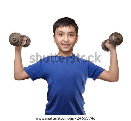 smiling boy exercise with dumbbells - stock photo
