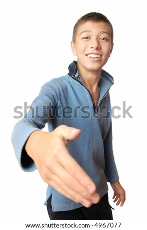 Smiling boy greets with his hand on a white background - stock photo