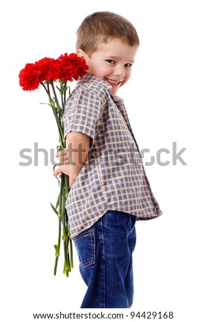 Smiling boy hiding a bouquet of red carnations behind itself, isolated on white - stock photo