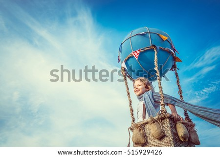 Smiling boy in a balloon in the sky