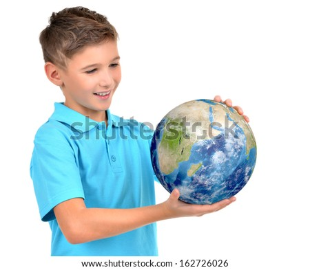 Smiling boy in casual  holding planet earth in hands and looks on it   -  isolated on white