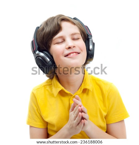 smiling boy in headphones listening to music, eyes closed - stock photo