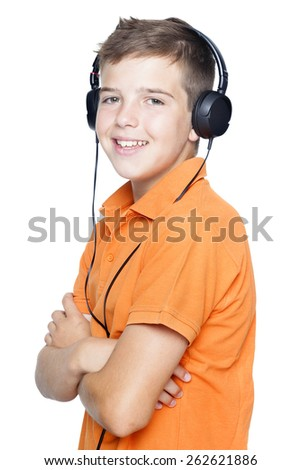 Smiling boy in headphones listening to music, isolated on white background - stock photo