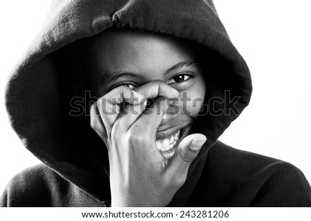 smiling boy in hoodie with face partially covered - stock photo