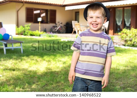 Smiling boy in the garden - stock photo