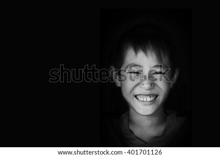 smiling boy in white tone on black background