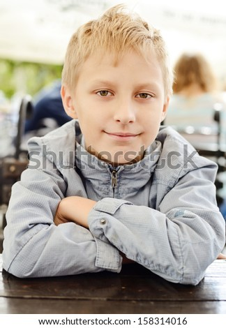 smiling boy looking at the camera - stock photo