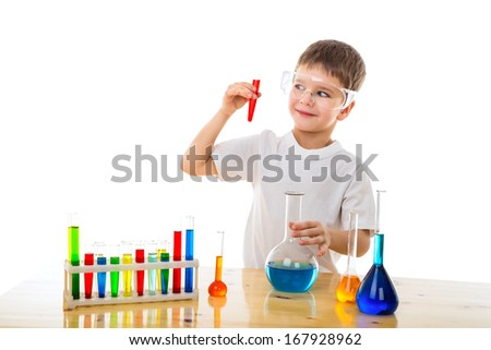 Smiling boy making chemical experiment, isolated on white - stock photo