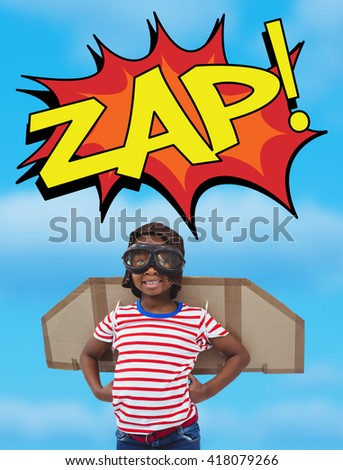 Smiling boy pretending to be pilot against a view of a blue sky - stock photo