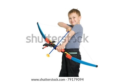 Smiling boy shooting a bow sports for children.