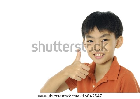 Smiling boy showing his thumbs