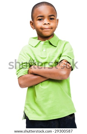 Smiling boy standing with his arms crossed isolated over white - stock photo